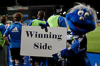 """Q holds up a """"Winning Side"""" sign along the Quakes sideline. The San Jose Earthquakes defeated the Houston Dynamo 2-0 at Buck Shaw Stadium in Santa Clara, California on June 4th, 2011."""