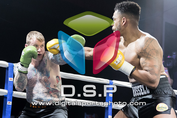 Joe Russell vs Jack Downing contest During EBA Boxing Vs Legends Gym. Photo by: Simon Downing.<br /> <br /> Saturday November 11th 2017 - Grays Civic Hall, Grays, Essex, United Kingdom.