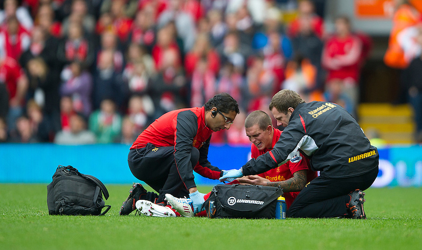 Liverpool's Daniel Agger receives treatment prior to being stretchered off..Football - Barclays Premiership - Liverpool v Manchester United - Sunday 23rd September 2012 - Anfield - Liverpool..