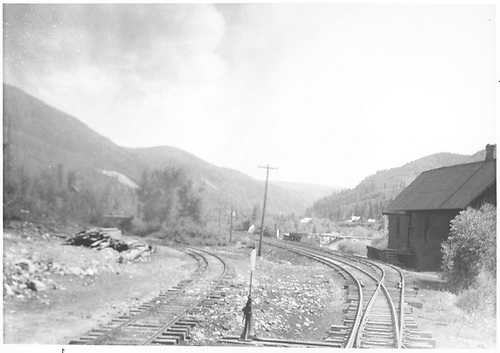 South-facing view of the north end RGS Rico yard entrance with warehouse on the right as seen from the switch stand.  The siding at left goes to the Pro Patria Mill.<br /> RGS  Rico, CO  Taken by Barriger, John W. III - 1935