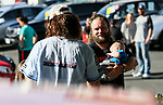 "Greg Murphy and Mullet owner Daniel McNicholl. Holden New Zealand, ""Mullet Amnesty Day"", trade your mullet for a Holden Astra, West City Holden, Auckland, New Zealand, Saturday 1st April 2017. Photo: Simon Watts/www.bwmedia.co.nz"