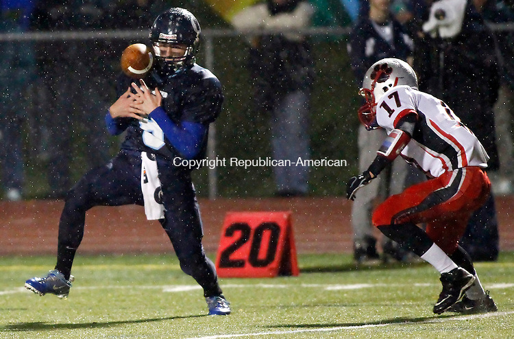 Southbury, CT-22 November 2011-110211CM10- Oxford's Justin Lasto bobbles the ball but is able to make the catch for a first down  Tuesday night in Southbury. Moving in to make the tackle is Pomperaug's Carl Gatzendorfer.  Pomperaug won 10-7.   Christopher Massa Republican-American