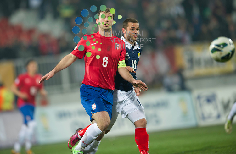 Bransilav Ivanovic of Serbia challenges for the ball against Shaun Maloney of Scotland during the Fifa World Cup Qualifier between Serbia and Scotland at Stadion Karadorde, Novi Sad, Serbia. 26 March 2013. Picture by Ian Sneddon / Universal News and Sport (Scotland). All pictures must be credited to www.universalnewsandsport.com. (Office) 0844 884 51 22. .