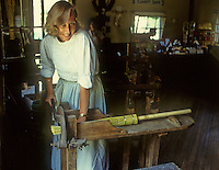 A volunteer re-enactor is the Broom Maker  at Pioneer Village, Lockport, Illinois