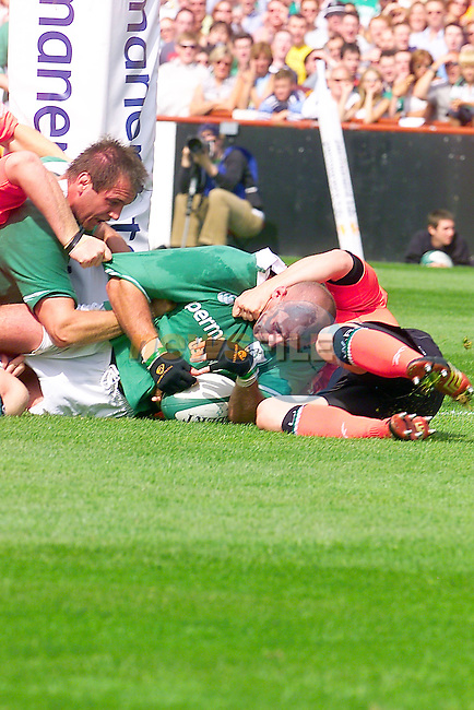 Irelands No 6 Victor Costello scoring Irelands second try during the 35 / 12 win over Wales in lansdowne Road, Dublin Ireland..Photo Fran Caffrey/Newsfile/AFP..This picture has been sent to you by:.Newsfile Ltd,.3 The View,.Millmount Abbey,.Drogheda,.Co Meath..Ireland..Tel: +353-41-9871240.Fax: +353-41-9871260.GSM: +353-86-2500958.ISDN: +353-41-9871010.IP: 193.120.102.198.www.newsfile.ie..email: pictures@newsfile.ie..This picture has been sent by Fran Caffrey.francaffrey@newsfile.ie