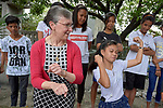 Harriett Olson, the chief executive officer of United Methodist Women, shares movement with a group of children in the Manila North Cemetery in Manila, Philippines, on January 16, 2018. Olson was in the Philippines to meet with women from throughout the region. United Methodist Women has long supported educational and other work in the cemetery carried out by the Kapatiran-Kaunlaran Foundation.