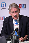 © Joel Goodman - 07973 332324 . 02/10/2017. Manchester, UK. Chancellor PHILIP HAMMOND being interviewed on LBC , at the start of the second day of the Conservative Party Conference at the Manchester Central Convention Centre . Photo credit : Joel Goodman
