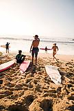 USA, Hawaii, surfers on beach at Waimea Bay