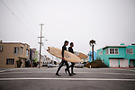 Danny Hess, left, who specializes in making custom surfboards out of sustainable wood, walks back with Josh Duthie, right, from surfing at Ocean Beach, in San Francisco, Ca., on Wednesday, July 6, 2011.