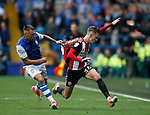 Jack Hunt of Sheffield Wednesday grabs the shirt of David Brooks of Sheffield Utd during the Championship match at the Hillsborough Stadium, Sheffield. Picture date 24th September 2017. Picture credit should read: Simon Bellis/Sportimage