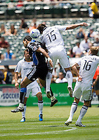 June 20, 2009:  Pablo Campos of Earthquakes and Stefani Miglioranzi of Galaxy jump for the ball during a game at Coliseum in Oakland, California. San Jose Earthquakes defeated Los Angeles, 2-1
