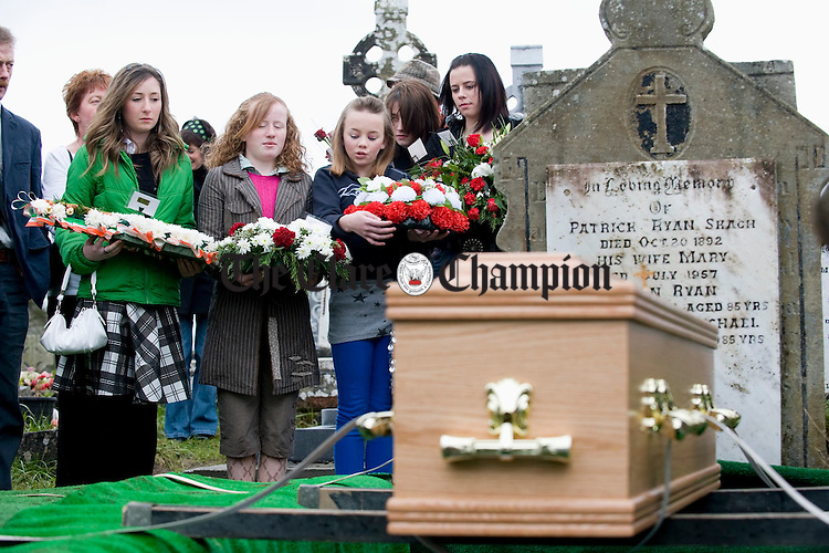 The coffin bearing the remains of musician Joe Ryan is placed on the family grave at Inagh before burial. Photograph by John Kelly.