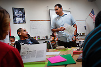 Lindsay, California, September 5, 2012 - Students in Eloy Garza's English class at Lindsay High School are broken into groups so that he can focus on each student's needs more effectively as well as allowing students that are on the same growth level to help one anothers. Advanced and semi advanced students use computers to work on literal and figurative language skills and expository essays, while other groups work on expository reading comprehension and those for whom English is a second language, he is able to give more specialized attention to. ..Lindsay High School began building a competency-based education model about 7 years ago, fully implementing it just over three years ago and is set to graduate its first class this school year. This model does away with traditional grading and pass/fail for grades. Instead students are expected to achieve proficiency in a range of areas in each class, where a 3 (equal to a traditional B) is passing; A 4 is considered intensive and usually denotes college bound. Says Principal Jaime Robles, ?This allows students to learn at there own pace. If a student is advanced, they can move ahead, and if a student is lagging, they get the support they need.? Part of this model allows for students who are more advanced dig deeper and push harder and truly move ahead of others. Because they are ahead, some spend the extra time learning more, others take concurrent classes at the nearby community college and some choose to graduate early to start their path. ?Each student has their own set of goals,? says English teacher Amalia Lopez, ?Whatever their goals are, we support them.?.Slug: DD_ CompetencyByline: Daryl Peveto / LUCEO for Education Week