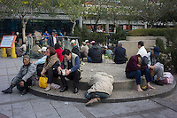 Homeless people gather outside the Lungshan Temple, also known as Mengchia Temple, in Taipei, Taiwan, 2015. The temple is located in Wanhua District, formerly called Mengchia, which was one of the earliest commercial districts in Taipei.