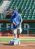 The grounds crew paints the batters box at Lindquist Field, home of the Ogden Raptors, before the game against the Orem Owlz in Pioneer League action at Lindquist Field on June 18, 2015 in Ogden, Utah.  (Stephen Smith/Four Seam Images)