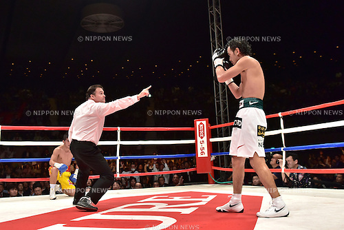 Shinsuke Yamanaka (JPN),<br /> OCTOBER 22, 2014 - Boxing :<br /> Shinsuke Yamanaka of Japan is led to a  neutral corner by the referee after knocking down Suriyan Sor Rungvisai of Thailand in the seventh round during the WBC bantamweight title bout at Yoyogi 2nd Gymnasium in Tokyo, Japan. (Photo by Hiroaki Yamaguchi/AFLO)