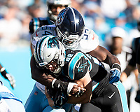 CHARLOTTE, NC - NOVEMBER 3: Christian McCaffrey #22 of the Carolina Panthers is tackled by Rashaan Evans #54 of the Tennessee Titans during a game between Tennessee Titans and Carolina Panthers at Bank of America Stadium on November 3, 2019 in Charlotte, North Carolina.