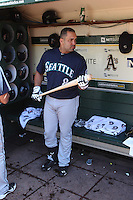 OAKLAND, CA - JUNE 15:  Kendrys Morales #8 of the Seattle Mariners gets ready in the dugout before the game against the Oakland Athletics at O.co Coliseum on Saturday June 15, 2013 in Oakland, California. Photo by Brad Mangin