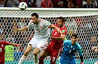 KAZAN - RUSIA, 20-06-2018: Omid EBRAHIMI (Der) jugador de RI de Irán disputa el balón con Sergio BUSQUETS (Izq) jugador de España durante partido de la primera fase, Grupo B, por la Copa Mundial de la FIFA Rusia 2018 jugado en el estadio Kazan Arena en Kazán, Rusia. /  Omid EBRAHIMI (R) player of IR Iran fights the ball with Sergio BUSQUETS (L) player of Spain during match of the first phase, Group B, for the FIFA World Cup Russia 2018 played at Kazan Arena stadium in Kazan, Russia. Photo: VizzorImage / Julian Medina / Cont
