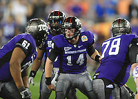 Jan. 4, 2010; Glendale, AZ, USA; TCU Horned Frogs quarterback (14) Andy Dalton yells in the huddle against the Boise State Broncos in the 2010 Fiesta Bowl at University of Phoenix Stadium. Mandatory Credit: Mark J. Rebilas-