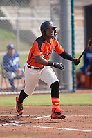 San Francisco Giants center fielder Heliot Ramos (31) hits a foul ball down the first base line during an Instructional League game against the Kansas City Royals at the Giants Training Complex on October 17, 2017 in Scottsdale, Arizona. (Zachary Lucy/Four Seam Images)