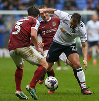 Bolton Wanderers' Filipe Morais battles with Northampton Town's Matthew Taylor and David Buchanan<br /> <br /> Photographer Alex Dodd/CameraSport<br /> <br /> The EFL Sky Bet League One - Bolton Wanderers v Northampton Town - Saturday 18th March 2017 - Macron Stadium - Bolton<br /> <br /> World Copyright &copy; 2017 CameraSport. All rights reserved. 43 Linden Ave. Countesthorpe. Leicester. England. LE8 5PG - Tel: +44 (0) 116 277 4147 - admin@camerasport.com - www.camerasport.com
