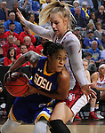 SIOUX FALLS, SD - MARCH 8:  Alexis Alexander #1 of South Dakota State drives on Nicole Seekamp #35 of South Dakota during the women's championship game of the 2016 Summit League Tournament at the Denny Sanford Premier Center in Sioux Falls, S.D. (Photo by Dick Carlson/Inertia)