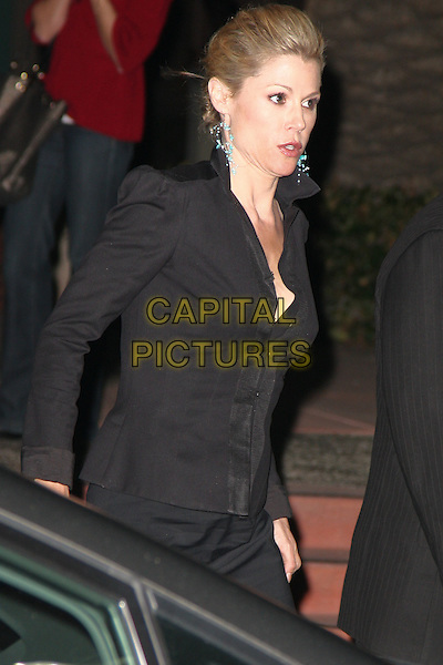 """JULIE BOWEN.Cast members sign autographs at An Evening With """"Modern Family,"""" at the Leonard H. Goldenson Theatre, Academy of Television Arts & Sciences. North Hollywood, CA, USA, .March 3rd 2010. .half length black jacket side profile .CAP/CEL .©CelPh/Capital Pictures"""