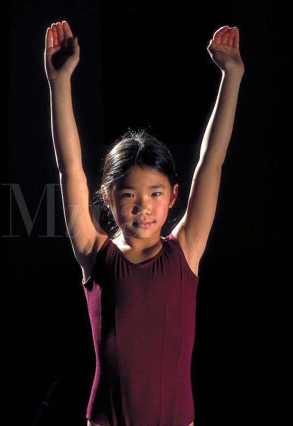 Asian gymnast prepares for vault