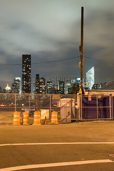 AVAILABLE FROM JEFF AS A FINE ART PRINT.<br /> <br /> AVAILABLE FROM CORBIS FOR COMMERCIAL/EDITORIAL LICENSING.  Please go to www.corbis.com and search for image # 42-21631818.<br /> <br /> Midtown Manhattan Skyline Illuminated at Night - Viewed from an Industrial Neighborhood in Hunters Point, Queens, New York City, New York State, USA....Prominent Buildings Visible on the Manhattan Skyline Include the Citigroup Center (fomerly the Citicorp Building) and the Trump World Tower
