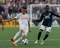 Foxborough, Massachusetts - May 30, 2018: First half action. In a Major League Soccer (MLS) match, New England Revolution (blue/white) vs Atlanta United FC (white), at Gillette Stadium.