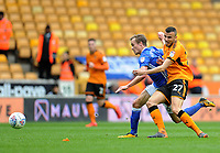 Birmingham City's Maikel Kieftenbeld vies for possession with Wolverhampton Wanderers' Romain Saiss<br /> <br /> Photographer Ashley Crowden/CameraSport<br /> <br /> The EFL Sky Bet Championship - Wolverhampton Wanderers v Birmingham City - Sunday 15th April 2018 - Molineux - Wolverhampton<br /> <br /> World Copyright &copy; 2018 CameraSport. All rights reserved. 43 Linden Ave. Countesthorpe. Leicester. England. LE8 5PG - Tel: +44 (0) 116 277 4147 - admin@camerasport.com - www.camerasport.com