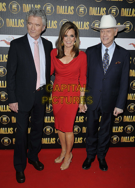 Patrick Duffy, Linda Gray & Larry Hagman.The Channel 5 Launch Party for the new series of 'Dallas', Old Billingsgate Market, London, England..21st August 2012.full length suit shirt jacket blue black pink tie white stetson cowboy hat red dress gold cuff bracelet .CAP/CAN.©Can Nguyen/Capital Pictures.