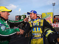 Feb 9, 2014; Pomona, CA, USA; NHRA funny car driver John Force (left) is congratulated by Matt Hagan as he celebrates after winning the Winternationals at Auto Club Raceway at Pomona. Mandatory Credit: Mark J. Rebilas-
