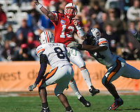 01 January 2007: Nebraska quarterback Zac Taylor (#13) tries to unleash a pass under heavy pressure from Auburn defenders during the 2007 AT&T Cotton Bowl Classic between The University of Auburn and The University of Nebraska at The Cotton Bowl in Dallas, TX.