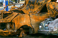 RUST: AUTOMOBILE<br /> Twisted Wreck<br /> West Haverstraw, NY<br /> Rust is a general term for a series of iron oxides. Colloquially, the term is applied to red oxides, formed by the reaction of iron and oxygen in the presence of water or air moisture.