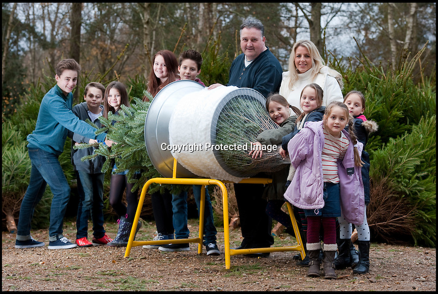 BNPS.co.uk (01202 558833)<br /> Pic: PhilYeomans/BNPS<br /> <br /> Think your Xmas is hectic??<br /> <br /> Rayna Warriner(39) from Bournemouth in Dorset has nine children to contend with every festive season, and even such simple tasks as getting the tree ready takes a military style operation.<br /> <br /> Present buying starts in the January sales, wrapping is a 3 day operation Xmas dinner is for 12...but at least the tree only takes a minute to dress, with 9 willing helpers.<br /> <br /> And both Stress manager Rayna and Police officer husband Malcolm manage to hold down full time jobs after packing the kids off to school every day.<br /> <br /> Rayna with husband Malcolm(53) and children l-r Jackson(14), Callan(11), Taitum(10), Eryn(16), Harrison(13), triplets Romany, Ilish and Meredith(8) and Avie(6).