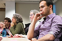 """Jacob Levine, 29, of New York, New York, listens as New York Assemblyman (79th District) and Vice Chair of the Democratic National Committee Michael Blake speaks to a live audience during a session of Resistance School in the Starr Auditorium in the Belfer Building of Harvard University's John F. Kennedy School of Government, on Thurs., April 27, 2017.  Blake's lecture was titled """"How to sustain the resistance long term.""""  The lecture, which was the fourth such session and the final in what the group calls the """"first semester"""" of Resistance School, was also streamed live on the internet. Resistance School was started by progressive graduate students at Harvard after the Nov. 8, 2016, election of President Donald Trump. Resistance School describes itself as a """"practical training program that will sharpen the tools [needed] to fight back at the federal, state, and local levels."""" The live lectures are streamed and archived online alongside other information on the Resistance School website. During the lectures, teams of volunteers engage with followers on social media, including Facebook and twitter, sharing soundbytes, quotations, and supplementary materials as the lectures happen."""