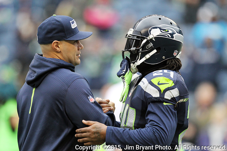 Seattle Seahawks assistant linebacker coach Lofa Tatupu and running back Marshawn Lynch stands on the sidelines before their game against the Carolina Panthers  at CenturyLink Field in Seattle, Washington on October 18, 2015. The Panthers came from behind with 32 seconds remaining in the 4th Quarter to beat the Seahawks 27-23..  ©2015 Jim Bryant Photography. All Rights Reserved..