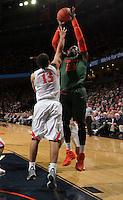 Miami center Tonye Jekiri (23) shoots over Virginia forward Anthony Gill (13) during an NCAA basketball game Saturday Feb, 24, 2014 in Charlottesville, VA. Virginia defeated Miami 65-40.