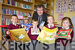 LET'S READ: Pupils form Glenderry national school, Ballyheigue at the official opening of the school library on Friday morning were delighted to meet real life author Gabriel Fitzmaurice (back centre). From l-r were: Nicholas Roche, Fionnan Duggan, Dylan Godley, Molly Casey and Sophie Quille.