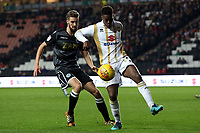Kieran Agard of MK Dons and Fiacre Kelleher of Macclesfield Townduring MK Dons vs Macclesfield Town, Sky Bet EFL League 2 Football at stadium:mk on 17th November 2018