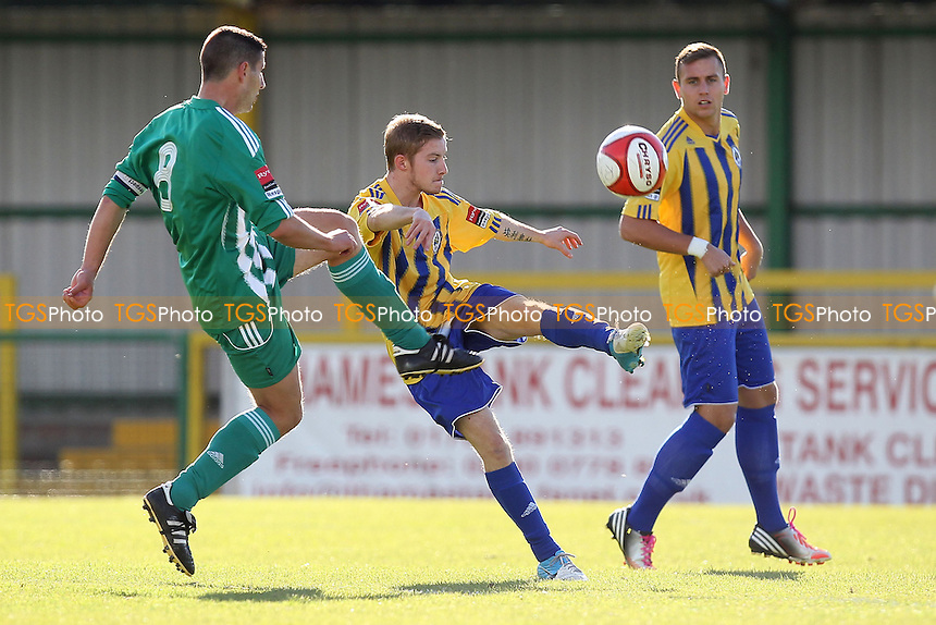 Elliot Long of Romford clears from Michael Simpson of Soham - Romford vs Soham Town Rangers - Ryman League Division One North Football at Ship Lane, Thurrock FC - 13/10/12 - MANDATORY CREDIT: Gavin Ellis/TGSPHOTO - Self billing applies where appropriate - 0845 094 6026 - contact@tgsphoto.co.uk - NO UNPAID USE.