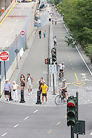 Cyclists, runners, and pedestrians utilize the paths and bike lanes on a section of the Hudson River Greenway north of West 46th Street in New York City.