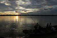 At sunset, a boat sails away from the pier in Kratie, Cambodia-2010