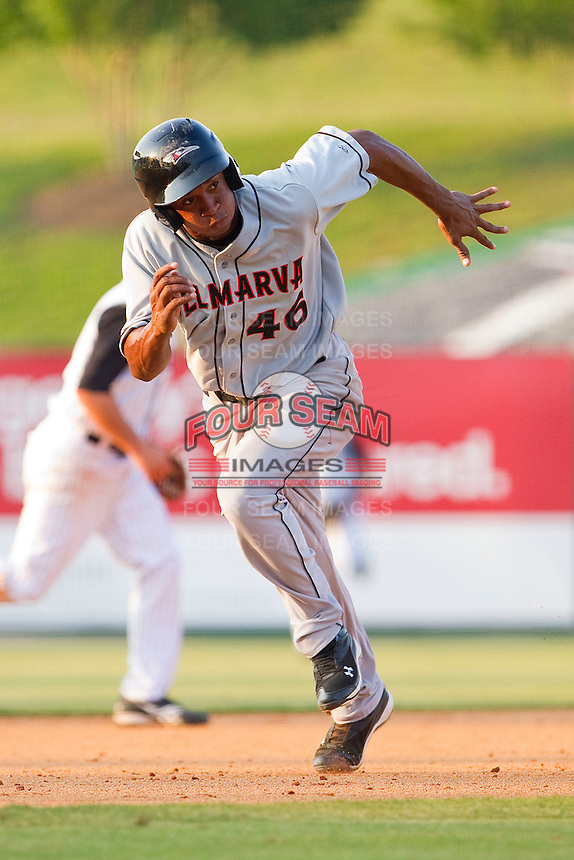 Jonathan Schoop #46 of the Delmarva Shorebirds takes off for third base against the Kannapolis Intimidators at Fieldcrest Cannon Stadium on May 22, 2011 in Kannapolis, North Carolina.   Photo by Brian Westerholt / Four Seam Images