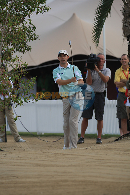 Padraig Harrington playing his second shot on the first on.day one of the Abu Dhabi HSBC Golf Championship 2011, at the Abu Dhabi golf club 20/1/11..Picture Fran Caffrey/www.golffile.ie.