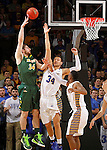 SIOUX FALLS, SD - MARCH 10: Cody Larson #34 from South Dakota State defends against a jumper over Chris Kading #34 from North Dakota State in the first half of the Summit League Championship Tournament game Tuesday at the Denny Sanford Premier Center in Sioux Falls, SD. (Photo by Dave EggenInertia)