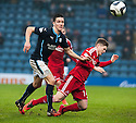 Aberdeen's Cammy Smith is bundled off the ball by Dundee's Thomas Konrad .