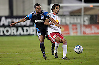Arturo Alvarez (left) battles against Mehdi Ballouchy (right). The New York Red Bulls defeated the San Jose Earthquakes 1-0 at Buck Shaw Stadium in Santa Clara, California on October 30th, 2010.